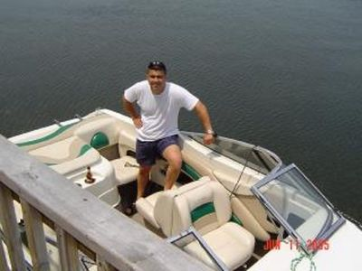 Friend and his boat next to deck