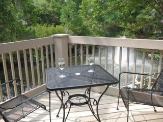Sea Pines condo photo - Enjoy meals or cocktails from open deck overlooking the lagoon