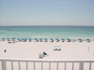 Balcony view of white sandy beaches and gorgeous emerald Gulf waters.