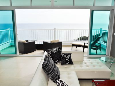 Large &  airy Living Room with modern furniture and endless ocean & beach views