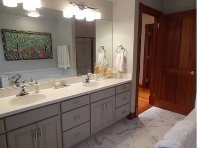 Double sinks, Carerra Gold Marble flooring, huge soaking tub and separate shower