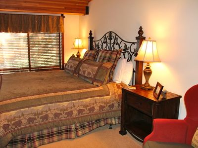 Kings Beach lodge rental - Lodge Master Suite: with king size bed, view of lake thru trees