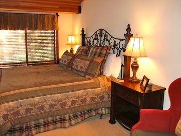 Lodge Master Suite: with king size bed, view of lake thru trees