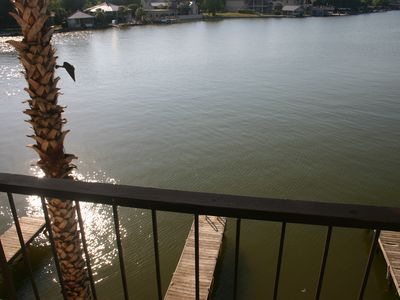 View of the lake and dock from the deck off of the main living area.