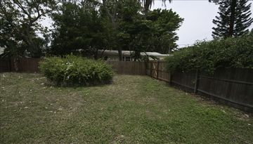 The Cottage features a large fenced backyard. Perfect for your dog or your