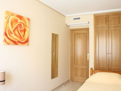 Bedroom 3 with twin beds, wardrobe, and flat screen TV/DVD, leading to hallway