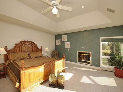 Large master bedroom with fireplace & glorious views