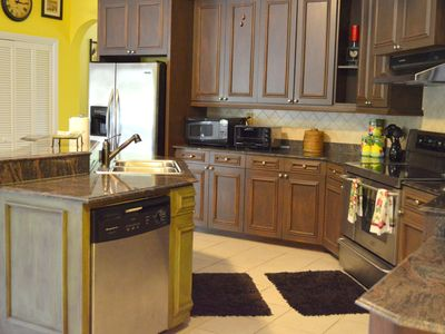 Gourmet Kitchen, spices, dishwasher, glass top stove, microwave, fully outfitted