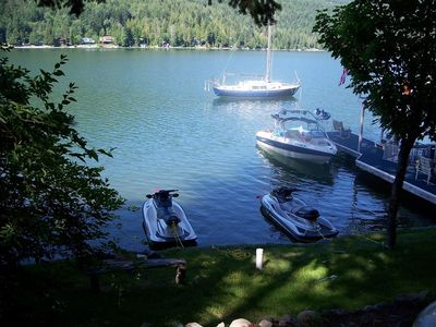 Bottle Bay cottage rental - View from cottage: Dock, watercraft tie up, lawn area, fire pit, swimming area