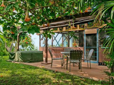 The Tropical Hideaway Studio-view of patio with hot tub and outdoor dining