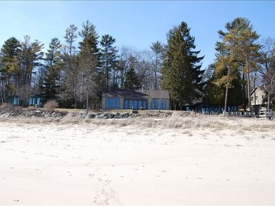The house and private beach surrounded by towering pines. Lake to beach to woods