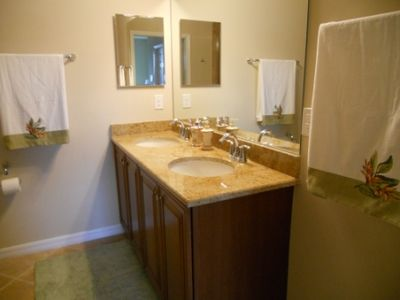 Granite counter top and double sinks in master bathroom