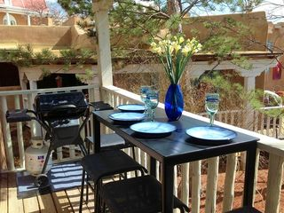 Enjoy dining and grilling on wisteria-covered balcony