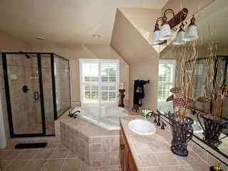 Windsor house photo - Tommy Bahama Bathroom with shower and jetted tub and double sinks