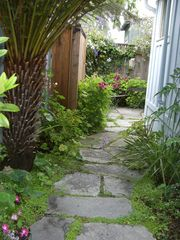 Pacific Grove cottage photo - Entry to enchanting rear garden with seating for three.