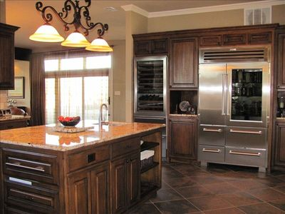 Kitchen has double convection ovens, Wolf range, Sub-Zero refrigerators.