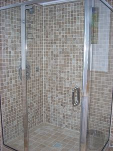 Glass-enclosed shower in bathroom of Ocean-view Bedroom
