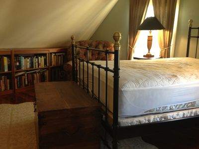 Guest bedroom featuring library area.