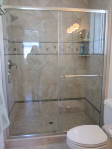 Step-in oversized custom tile shower.