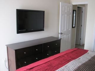 Emerald Island townhome photo - Large flat screen TV in master bedroom
