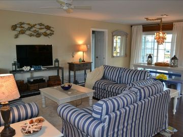 Enjoy our sunny and cozy living area with flat screen,cable,DVD, and canal views