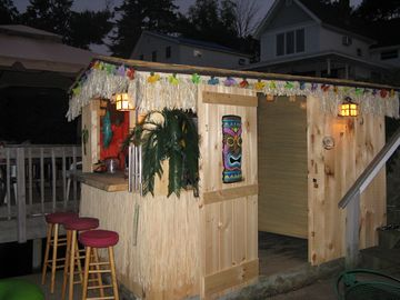 Tiki Hut lit up at night