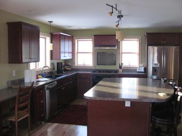 The fully equipped kitchen with large island, and all new appliances! Perfect !