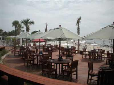 The Beach Club with outdoor dining, pools and beach overlooking the ocean