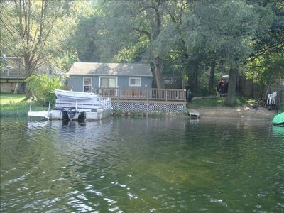 View of cottage from the lake, note sandy beach area