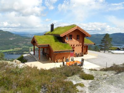New cottage with views of mountains, lakes and a village, WLAN, sauna, canoe