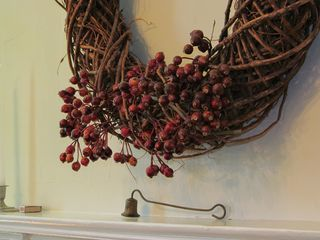 Woodstock house photo - Wreath over fireplace in dining room. Plenty of firewood!