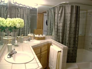 St. George condo photo - Bathroom with his and hers sinks and an oversized tub with shower