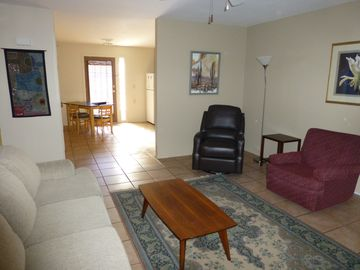 Tempe apartment rental - Living Room with comfortable swivel/rocker recliner and ceiling fan