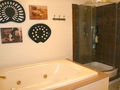 Large upstairs bathroom with tub and tiled shower