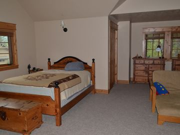 Spacious upstairs bedroom looking left, queen bed