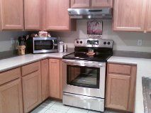 Stainless Steel Electric Range and Microwave. Pots, pans, plates, utensils etc