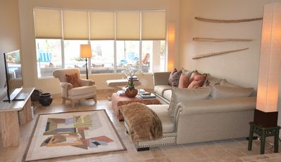 "Scottsdale house rental - The family and media room - with a huge 60"" LED TV, Xbox 360 and view of pool."