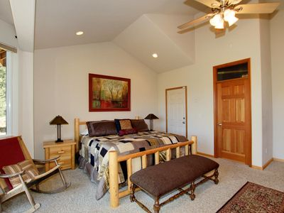 Spacious master bedroom, walk-in closet, emergency exit, fireplace, jacuzzi tub.