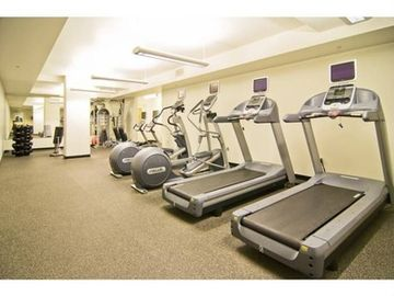 Gym included in complex with cardio, weights, and pilates equipment.