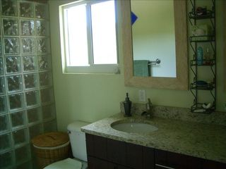 Cayman Brac house photo - Master Bath with over-sized shower, two sinks, granite and bluff views