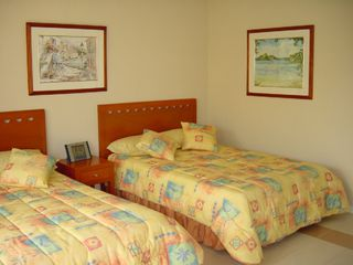 Puerto Aventuras condo photo - Bedroom - main floor - two double beds