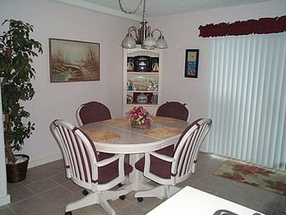 Dining Area with Sliding Door to Balcony (2 additional chairs not show) - Myrtle Beach Resort condo vacation rental photo