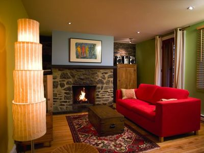 Fieldstone wall with fireplace (and sofa bed)