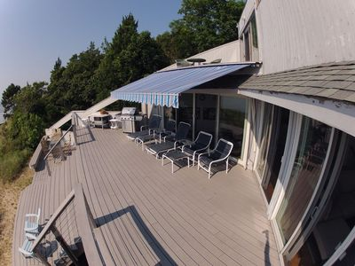 Expansive deck with a fantastic view of the private beach.