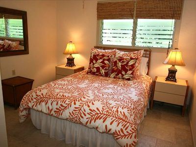 "GUEST BEDROOM W/QUEEN BED DECORATED IN ORANGE ""HAPU"""