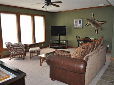 Lower Lever Family Room with flat screen TV, WII system, shuffle board and darts