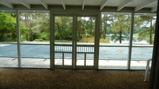Cape Charles cottage photo - Enjoy the enclosed screened patio