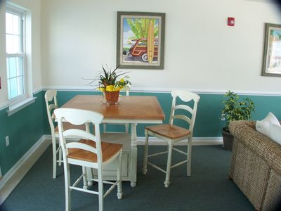 Card table in recreation room adjacent to pool
