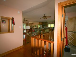 Napili house photo - Upstairs hall looking toward living area and kitchen and laundry room