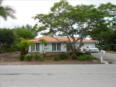 "Sanibel Island house rental - Welcome to ""Home at Last"" and our Royal Poinciana tree."